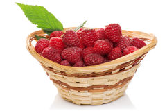 Ripe raspberries in basket with mint on white. Ripe raspberries in basket with mint isolated on white Royalty Free Stock Photos