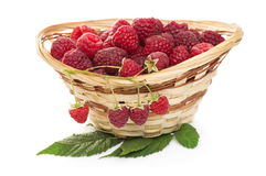 Ripe raspberries in basket with mint on white. Ripe raspberries in basket with mint isolated on white Stock Photo