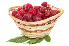 Ripe raspberries in basket with mint on white. Ripe raspberries in basket with mint isolated on white Stock Photography