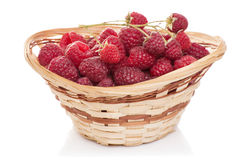 Ripe raspberries in basket with mint on white. Ripe raspberries in basket with mint isolated on white Stock Photos