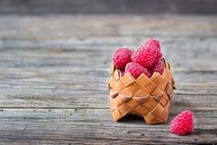 Ripe raspberries in a basket.  Stock Image