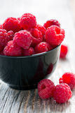 Ripe raspberries in a bowl. Royalty Free Stock Photos