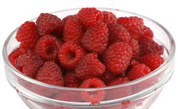 Ripe raspberries in a glass bowl Royalty Free Stock Image