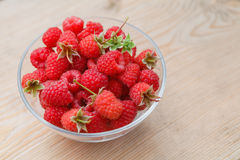 Ripe raspberries in glass bowl. Close-up. Stock Image
