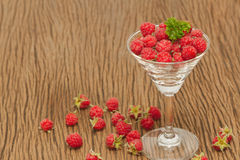Ripe raspberries in glass Stock Photo