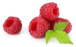 Ripe raspberries with green leaf isolated on white background Stock Images