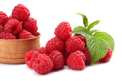 Ripe raspberries with green leaf isolated on white background. Macro Royalty Free Stock Photos