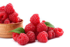 Ripe raspberries with green leaf isolated on white background macro. Ripe raspberries with green leaf isolated on a white background macro Stock Images