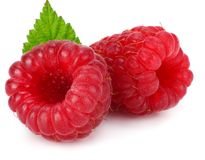 Ripe raspberries with green leaf isolated on white background macro Stock Image