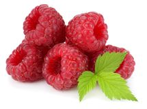 Ripe raspberries with green leaf  on white background Stock Images