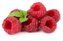 Ripe raspberries with green leaf  on white background macro Stock Photos