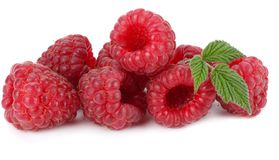 Ripe raspberries with green leaf  on white background macro Royalty Free Stock Photography