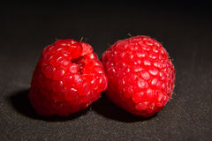 Ripe raspberries isolated. Ripe raspberries on black background close up Royalty Free Stock Photography