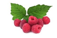 Ripe raspberries with leaves  on white Stock Image