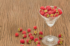 Ripe raspberries with mint in glass Stock Photography