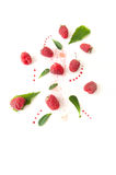 Ripe raspberries, mint leaves and jam drops on a white backgroun. D Stock Images