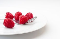 Ripe raspberries on a plate Stock Photography