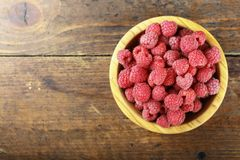 Fresh raspberry in a wooden plate. Ripe raspberries on a plate, close up Stock Photography
