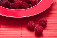 Ripe raspberries on a red underground Stock Images
