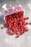 Ripe raspberries scattered on the table Royalty Free Stock Images