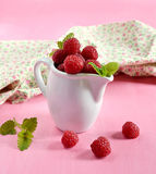 Ripe raspberries in a white jug with mint Royalty Free Stock Photo