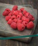 Ripe raspberries on wood Stock Photography