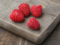 Ripe raspberries on wood Stock Images