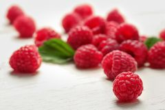 Ripe raspberries on wooden table. Ripe aromatic raspberries on wooden table Royalty Free Stock Images