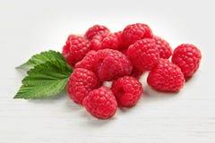 Ripe raspberries on wooden table. Ripe aromatic raspberries on wooden table Stock Photos