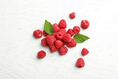 Ripe raspberries on wooden table, top view. Ripe aromatic raspberries on wooden table, top view Royalty Free Stock Photo