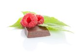 Ripe raspberry on chocolate bar Royalty Free Stock Photography