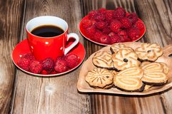 Ripe raspberry coffee cup and cookies Stock Image