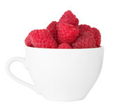 Ripe raspberry in cup Royalty Free Stock Image