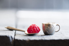 Ripe raspberry in a cup with a heart. Ripe raspberry in a cup on the table Royalty Free Stock Photography