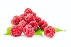 Ripe raspberry with green leaf on white background.  Stock Image