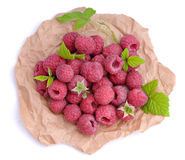 Ripe raspberry with green leaves. Summer dessert Royalty Free Stock Photo