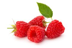 Fresh ripe raspberry with leaf isolated on the white background. Ripe raspberry with leaf isolated on the white background Royalty Free Stock Images