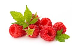 Fresh ripe raspberry with leaf isolated on the white background. Ripe raspberry with leaf isolated on the white background Stock Images