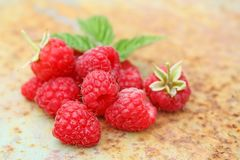 Ripe raspberry with a leaf. On an old metal background Stock Photos