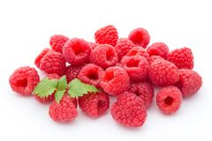 Ripe raspberry with leaf  on the white background. Ripe raspberry with leaf  on the white background Stock Photography