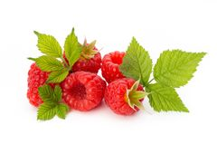 Ripe raspberry with leaf  on the white background. Fresh ripe raspberry with leaf  on the white background Stock Photos