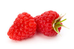 Ripe raspberry with leaf  on the white background. Fresh ripe raspberry with leaf  on the white background Royalty Free Stock Photography