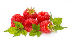 Ripe raspberry with leaf  on the white background. Fresh ripe raspberry with leaf  on the white background Royalty Free Stock Photo