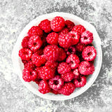 Ripe Raspberry in a white bowl over vintage textuted background,. Close up, square image Stock Photo