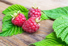 Ripe raspberry. On wood table Royalty Free Stock Images