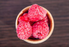 Ripe raspberry in a wooden bowl Royalty Free Stock Photos
