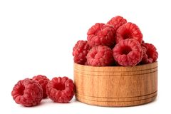 Ripe raspberry in a wooden plate on a white, isolated. Ripe raspberry in a wooden plate on a white background, isolated Stock Photos