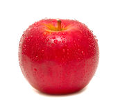 Ripe red apple. Juicy ripe red apple covered by droplets. Isolation Stock Image