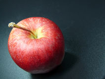 Ripe red apple. Closeup of ripe red apple with dark studio background Stock Images