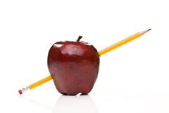 Ripe red apple. With pencil royalty free stock photo